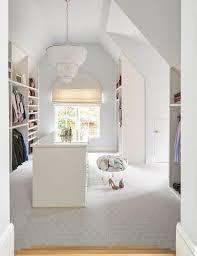 white beaded tier chandelier over closet island