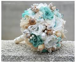 flowers for a beach wedding. seashells wedding bouquet for beach wedding. turquoise and beige bouquet. this is perfect. the scheme anyways. flowers a w