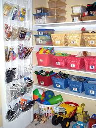 Bonus room closet in this home does double duty to store kid's toys & mom's  craft supplies. Organized by Little Virgo Organizing.