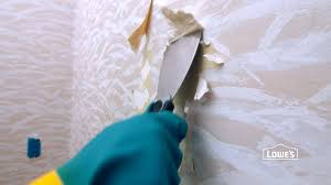 learn how to prep walls for painting a room including removing wallpaper repairing holes in drywall and cleaning the walls then watch how to paint a room