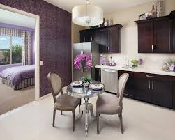 the colonnade apartments phoenix transitional dining room and chairs dark wood cabinets doorway drum pendant fridge