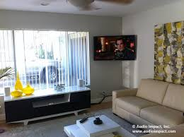 tv on wall corner. after tv on wall corner