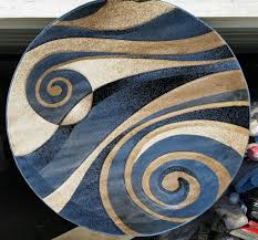 modern round area rug complete with a beige brown and blue