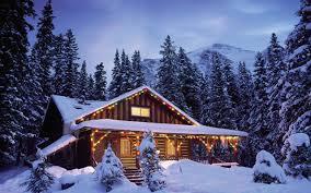 Peisaje de Iarna: Cabane de Lemn la Munte