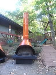 i want to create an outdoor fireplace on my patio see attached image can i gas logs that can be connected to a propane tank barbeque grill type