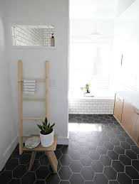 black hex tiles and white grout and white subway tiles with black grout