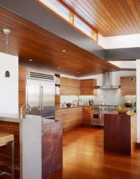 amazing tropical kitchen deep red countertop with stainless steel gray countertop paired wood ceiling and
