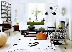 space living room olive: olive green living room with serge mouille lamp ikat chair and cowhide rug