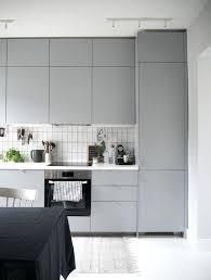 grey tile backsplash kitchen a kitchen with grey kitchen cabinets and white tile light gray subway tile kitchen backsplash