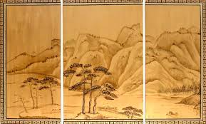 a chinese landscape is painted on wood panels with gold paint and wood stain the traditional oriental border and painting techniques create an old world