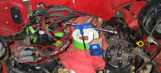 help i need a vg30e fuel injector wiring harness infamous the harness is shown under the red circles the green spots on my harness are strips of tape telling me where they go when i reassemble so yours will not