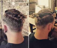 a cool topknot hairstyle with an undercut and a hipster beard