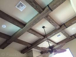 Creating your own coffered ceiling can be easily done when you use  simulated wood beams.
