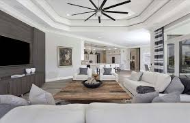 contemporary living room with gray walls rustic wood coffee table and white furniture