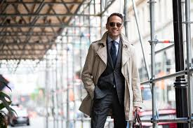 a 3 4 length trench is the perfect piece of transitional outerwear and here s why