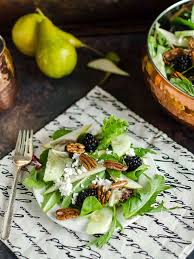 salad background. Delighful Salad A Plate Full Of Mixed Green Salad Recipe That Contains Field Greens Fresh  Pear Slices On Salad Background U