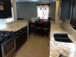 custom granite countertops with dark cabinets image