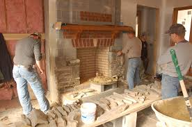 installing the cultured stone on the legs of the fireplace face
