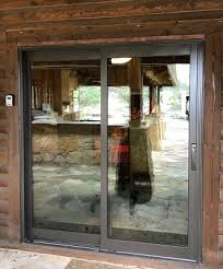 outside image of wimberley home with new wood sliding patio door
