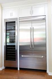 Jenn Air Integrated Built-In French Door Refrigerator next to a Miele wine  fridge has this kitchen ready and prepared for the everyday to the most ...