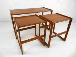 this well crafted set of three teak side tables uniquely nest together sy construction with set of mid century modern