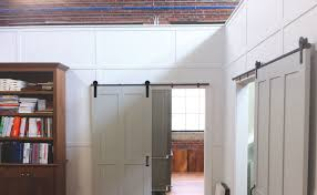 rolling barn doors help transform a reclaimed building into a beautifully functional office