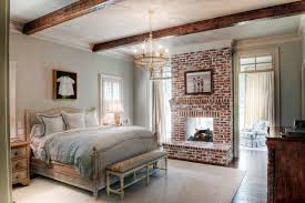 Electric Fireplace Inserts Bedroom  Traditional With Area Rug Bench Seat Brick Fireplace Carved Wood Chandelier