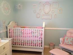 Elegant vintage style crib and DIY wall arrangment in a baby girl shabby  chic nursery design