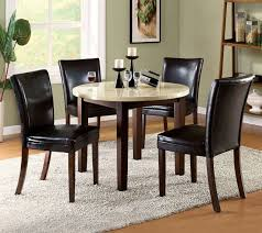narrow round marble top dining table with four black leather chairs for small space terrific