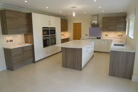 Gloss Magnolia and Grey acacia wood by Hacker at The Kitchen
