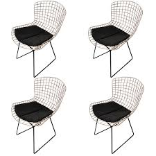 set of four original harry bertoia knoll wire chairs