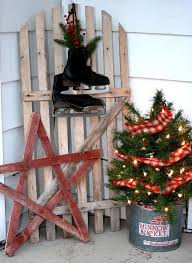 Cozy rustic outdoor christmas decoration ideas Christmas Tree Minnow Bucket With Tiny Tree Lights And Plaids Can Be The Perfect Idea For Rustic Decor Here It Is Accentuated With Wooden Star And Skate Shoes Christmas 2019 Top Rustic Outdoor Christmas Decorations Christmas Celebration