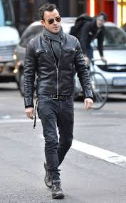 this combo of a black leather jacket and black jeans spells comfort and style and