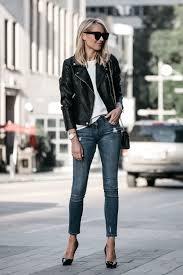 blonde woman wearing nordstrom anniversary black leather moto jacket denim skinny jeans louboutin black