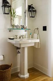 cottage powder room with carriage lantern sconces