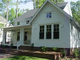 Just love this new farmhouse style home with batten board siding ...