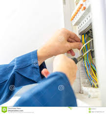 electrician installing an electrical fuse box royalty stock electrician installing an electrical fuse box