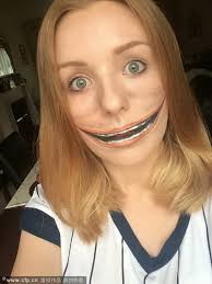 make up artist creates special effects on her face
