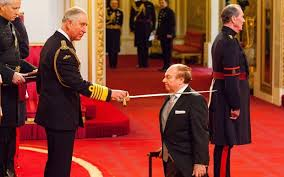 Newly-knighted Van Morrison promises Prince Charles he won't be retiring