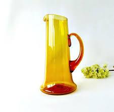 blown glass pitcher mid century modern amber glass pitcher glass applied handle blown glass tall pitcher vintage hand blown green glass pitcher