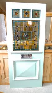 simple stained edwardian style three over one panel stained glass front door throughout