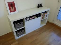 let s face it litter boxes are gross even if they have covers on them this elegant of ikea s expedit shelving serves both as storage and as a hiding