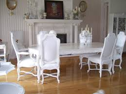 white dining room set with upholstered dining chairs with wooden base and rectangular white wooden table
