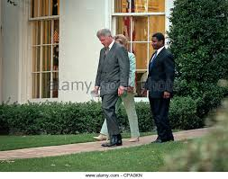 us president bill clinton with first lady hillary clinton and flanked by transportation secretary rodney slater bill clinton oval office