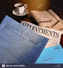 job application form and newspaper appointments pages on desk job application form and newspaper appointments pages on desk coffee cup