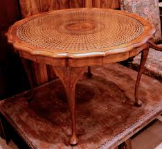 vintage french walnut coffee table with cane and glass top sold with cane coffee