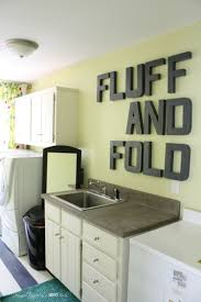 amazing diy laundry room renovation for less than one hundred dollars