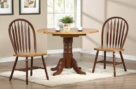 appealing round kitchen table with leaf design with 2 chairs and fur rug