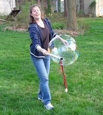 bubbles form technique blowing bubbles with the magic bubble wand