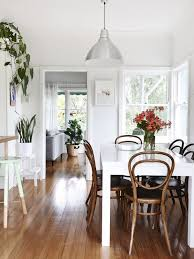 dining room with garden views love the bentwood chairs apartment decor inspiration
